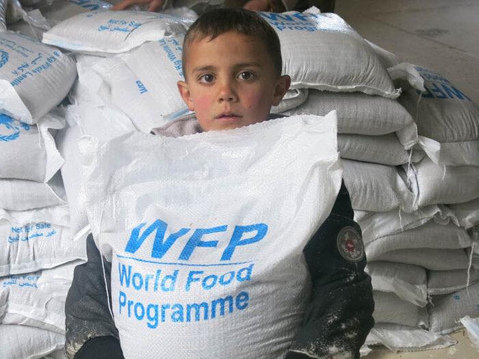 boy with WFP food bag