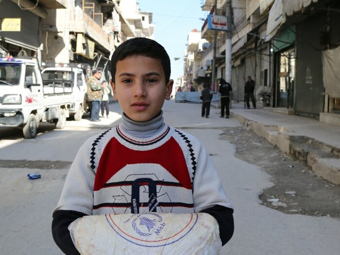 boy with wfp food